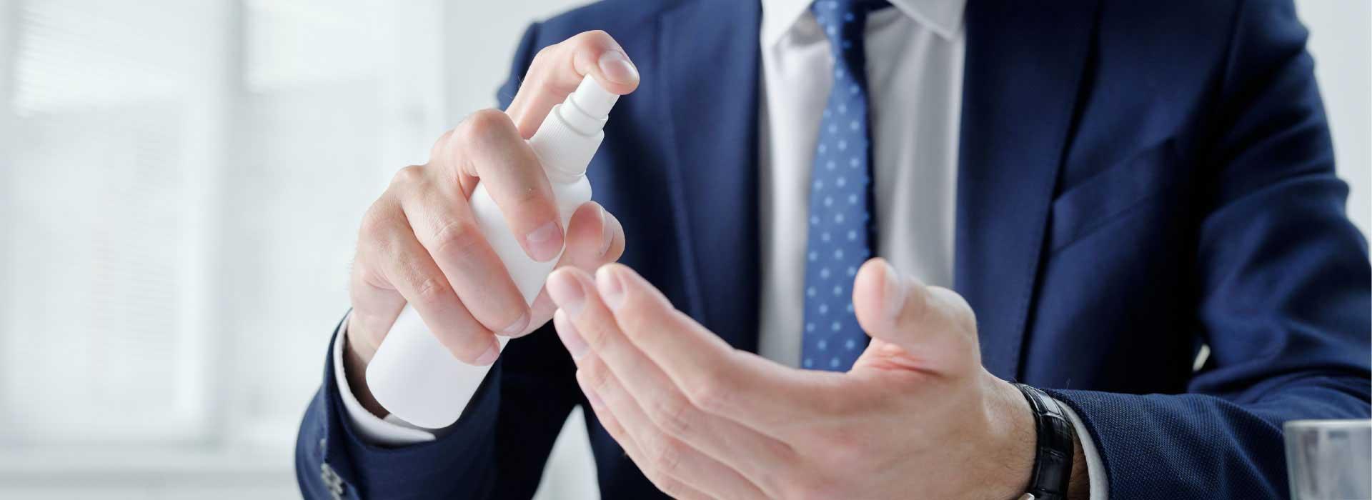 Sanitising hands in office
